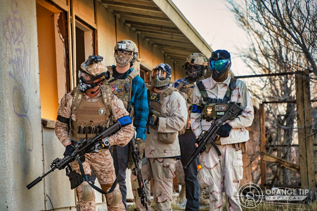 Airsoft players preparing to breach a building